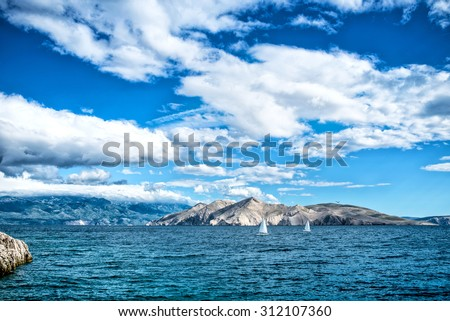 Island seaside or ocean landscape, travel image of boats, clear sky and water. Cliffs and ocean landscape - stock photo