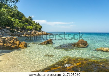 Island with clean and clear water at Perhentian Island, Malaysia - stock photo