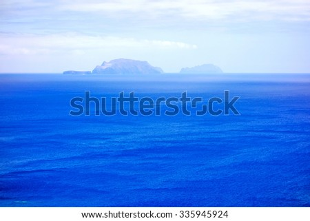 Islands (Ilhas Desertas) in the east of Madeira, from left to right named Chao, Deserta Grande, and Bugio - view from town Canical - stock photo