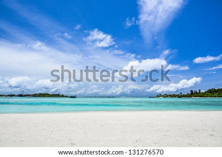 Islands in the lagoon under a cloudy sky - stock photo
