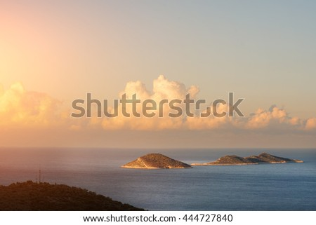 Islands in the sea and sunny sky with clouds - stock photo