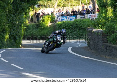 ISLE OF MAN, UK - MAY 31 2016: riders undertake qualifying laps of the annual TT (Tourist Trophy), Union Mills.