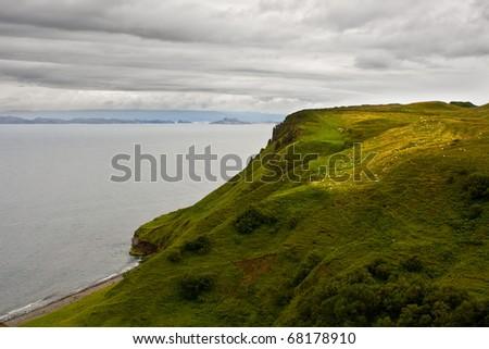 Isle of Skye, Scotland - coast with many sheep on hills - stock photo