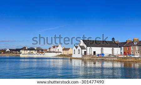 Isle of Whithorn Waterfront.  The view across Isle of Whithorn Bay to the small coastal village of Isle of Whithorn in Dumfries and Galloway, Southern Scotland. - stock photo