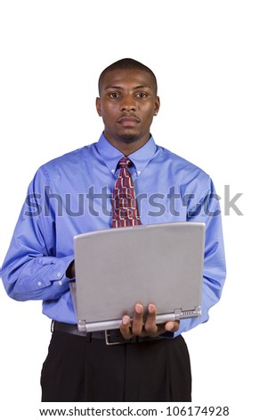 Isoalted Young black Businessman working on laptop while standing up - stock photo
