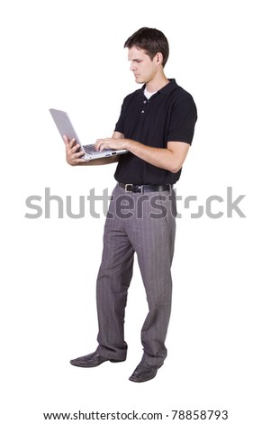 Isoalted Young Businessman working on laptop while standing up - stock photo