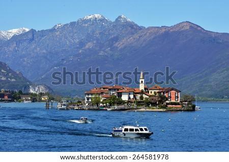 ISOLA PESCATORI-ITALY 25 APRIL 2013: fishing village Isola dei Pescatori on Lake Maggiore, Italy; ISOLA PESCATORI-ITALY 25 APRIL 2013 - stock photo
