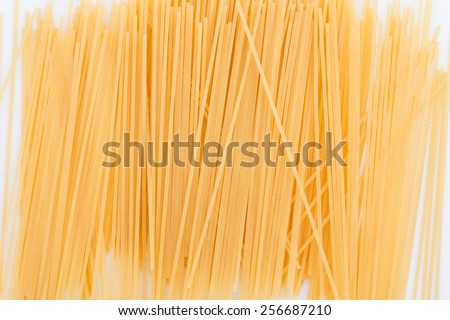isolanted uncooked spagetti pasta on white background - stock photo