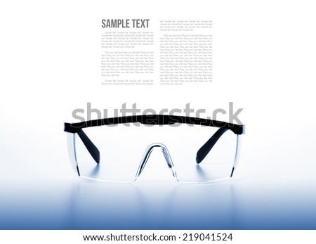 isolate clear safety glasses background with filtered - stock photo