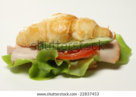 isolate croissant sandwich , fast food for breakfast or lunch.