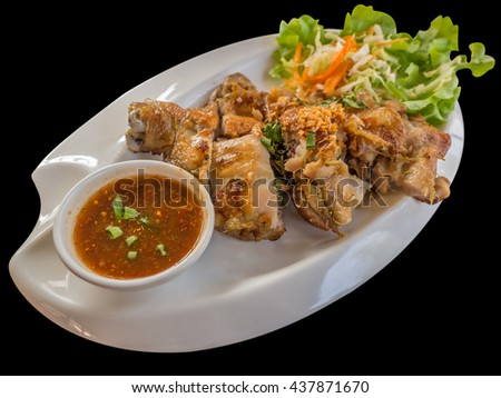 isolate of chicken grill with herb and spicy sauce - stock photo
