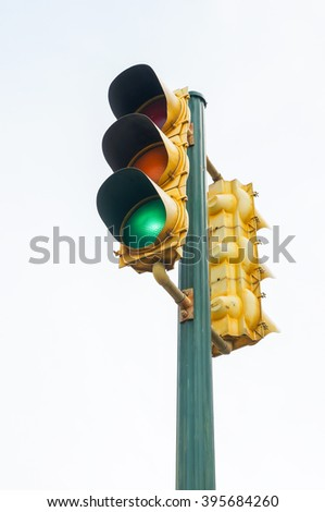 Isolate of old traffic light , color is yellow - stock photo