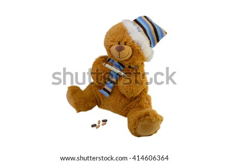 isolate the macro children's toy teddy bear in a scarf with tablets takes temperature a mercury glass thermometer - stock photo