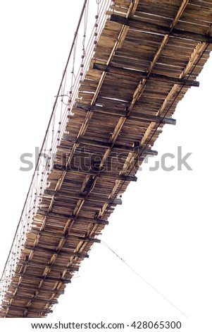 Isolate view beneath an old wooden bridge under which weathered through long usage. - stock photo