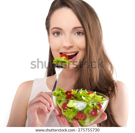 isolated a beautiful girl eat salad on white background - stock photo