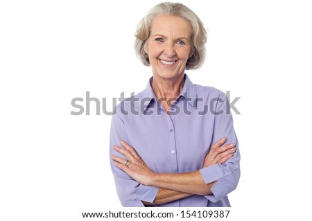 Isolated aged lady posing with crossed arms