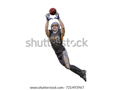 Isolated american football player catching the ball