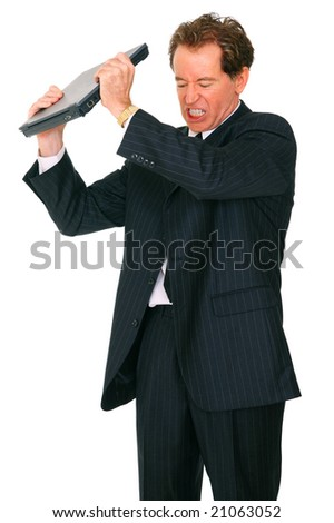 isolated angry, upset, or stress businessman holding up laptop and about to throw it