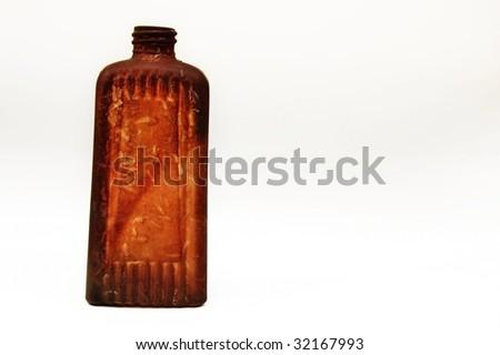 Isolated antique bottle on white - stock photo