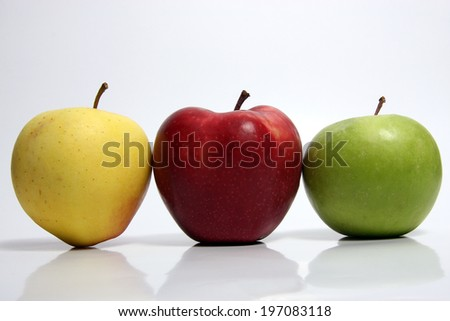isolated apples in yellow and red and green