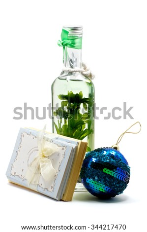 Isolated aroma-oil lamp with greeting cards and christmas ball tree - stock photo