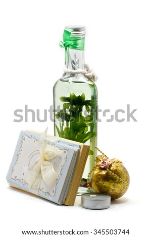 Isolated aroma-oil lamp with greeting cards, candle and christmas ball tree - stock photo
