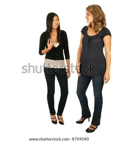 isolated asian and caucasian girls standing and chatting with each other