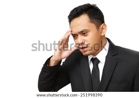 Isolated asian business man headache problem - stock photo