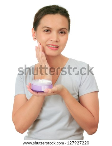 Isolated asian middle age  woman with cosmetic cream - stock photo