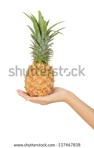 Isolated  asian woman hand with pineapple - stock photo