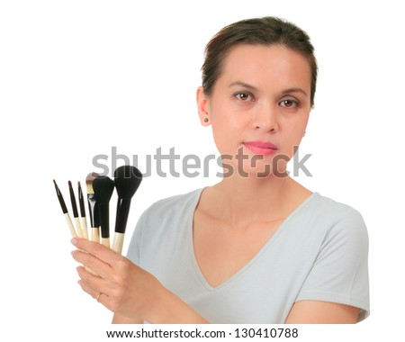 Isolated asian woman holds make up brushes - stock photo