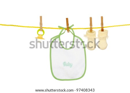 Isolated baby bib socks on a clothes line - stock photo