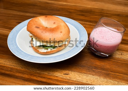 Isolated Bagel Omelet and bacon sandwich top view  - stock photo