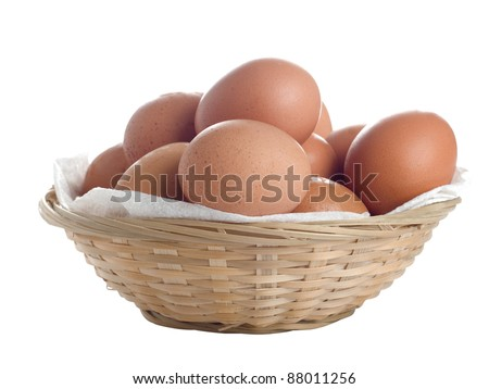 Isolated basket with brown eggs