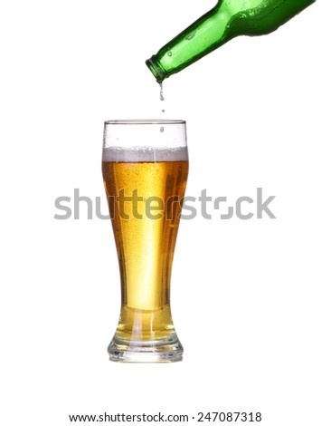 Isolated Beer is poured into a glass - stock photo