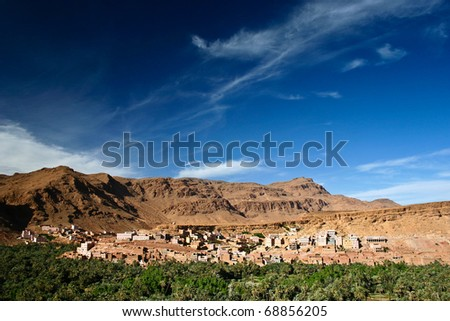 Isolated Berber oasis near Ouarzazate, Atlas Mountains in Morocco - stock photo