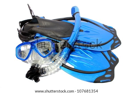 Isolated black and blue fins, snorkel, and mask used for snorkeling and diving. - stock photo