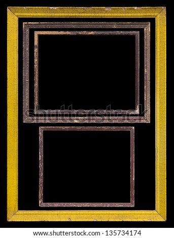 Isolated black background of the old wooden frames stacked from small to large.
