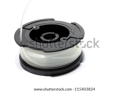 Isolated black cased weed trimmer spool with clear wire
