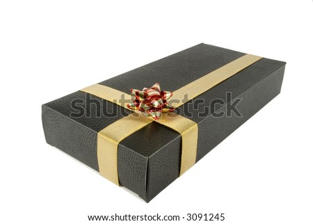 Isolated black gift box with golden ribbon and red bow