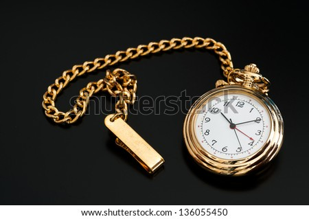 Isolated black image of a pocket watch - stock photo
