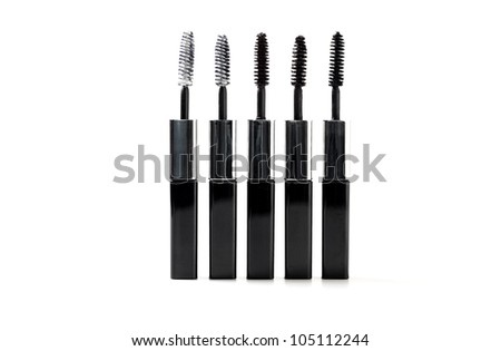 Isolated black mascara with brush laying on white background - stock photo