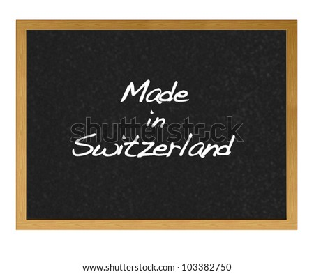 Isolated blackboard with Made in Switzerland.