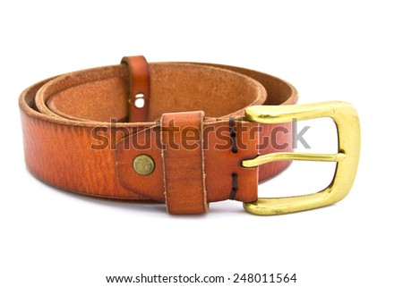 Isolated brown leather belt with brass buckle on white background
