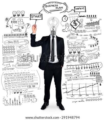 Isolated bulb head man writing business plan - stock photo