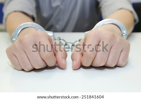 isolated business man arrested with handcuffs - stock photo