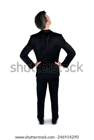 Isolated business man looking up - stock photo
