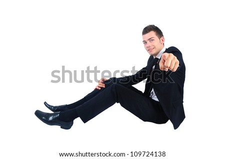 Isolated business man pointing at camera