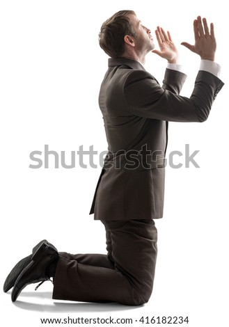 Isolated business man pray position on white background - stock photo