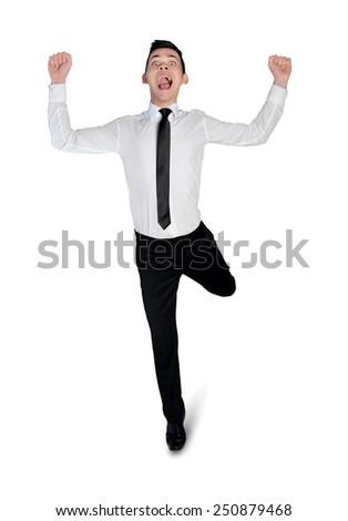 Isolated business man running winner - stock photo